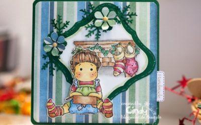 Weihnachtskarte – Unwrapped Tilda am Kamin