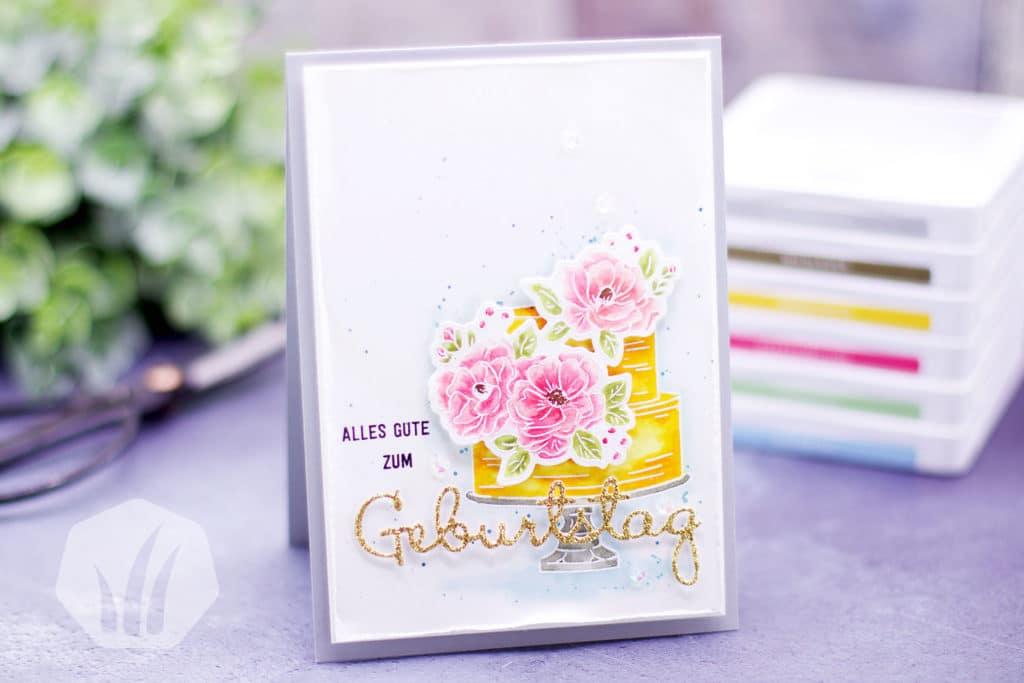 Geburtstagskarte mit Torte und Blumen