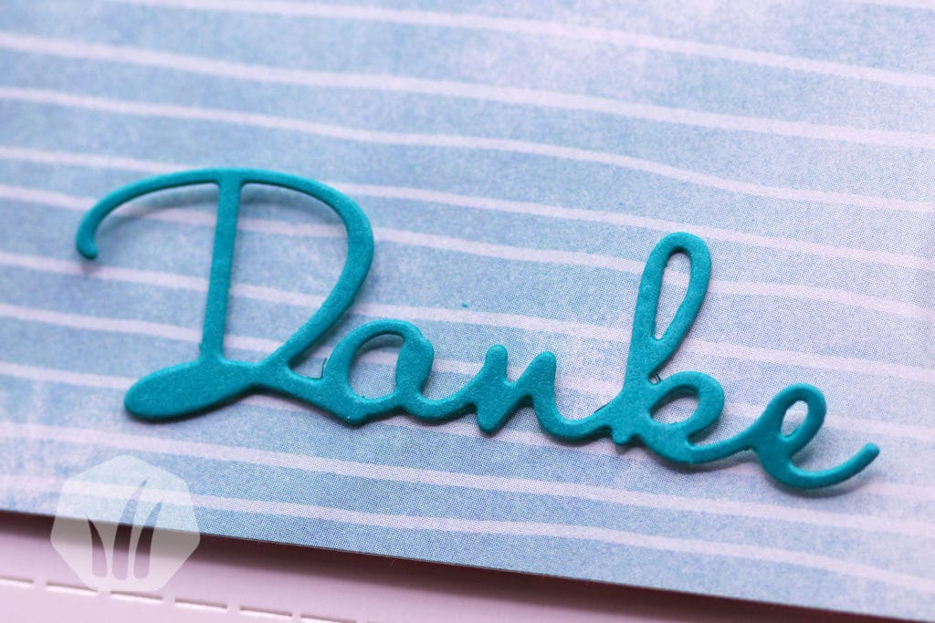 Merci Schokolade blumig verpackt: Detail Schrift